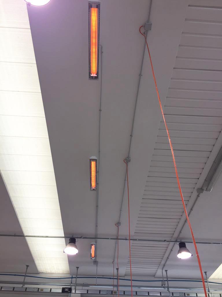 Installazione Lampade infrarossi per zone di lavoro in Capannone di 2.000 mq.